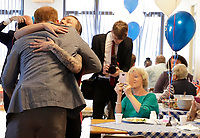 14 May 2019 - Prince Harry Duke of Sussex, gets a hug as he visits the community cafe during a visit to Barton Neighbourhood Centre in Oxford. The centre is a hub for local residents which houses a doctor's surgery, food bank, cafe and youth club. Photo Credit: ALPR/AdMedia