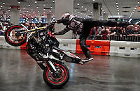 Red bull pilot rides a motorcycle during the International motorcycle show in New York, United States. 18/12/2013. Photo by Kena Betancur/VIEWpress.