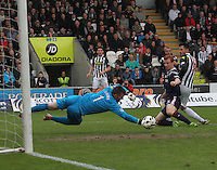 Mark Brown makes a crucial save watched by Steven Thompson (right) and Scott Boyd  in the St Mirren v Ross County Scottish Professional Football League Premiership match played at St Mirren Park, Paisley on 3.5.14.