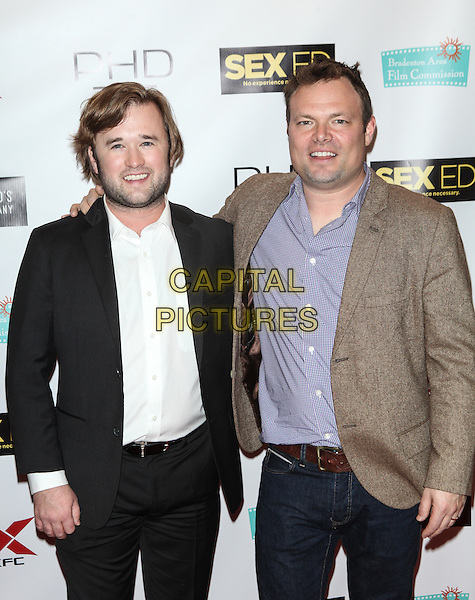 NEW YORK, NY - NOVEMBER 7: Haley Joel Osment AND Isaac Feder attend the 'Sex Ed' New York Premiere at AMC Empire 25 theater on November 7, 2014 in New York City.   <br /> CAP/MPI/COR<br /> &copy;Corredor99/ MediaPunch/Capital Pictures