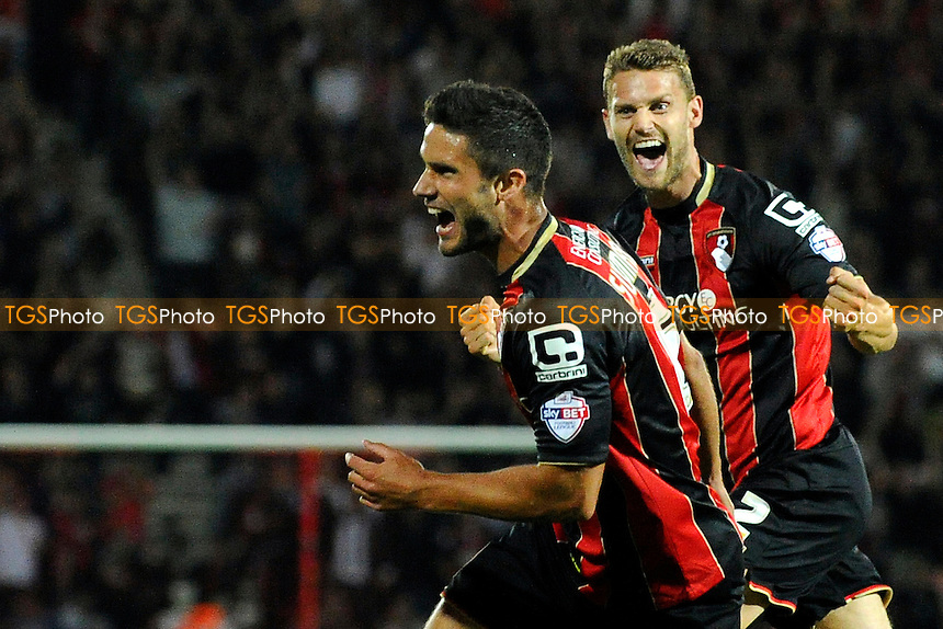 Andrew Surman of AFC Bournemouth left celebrates his goal with Simon Francis of AFC Bournemouth - AFC Bournemouth vs Leeds United - Sky Bet Championship Football at the Goldsands Stadium, Kings Park, Boscombe, Bournemouth, Dorset - 16/09/14 - MANDATORY CREDIT: Denis Murphy/TGSPHOTO - Self billing applies where appropriate - contact@tgsphoto.co.uk - NO UNPAID USE