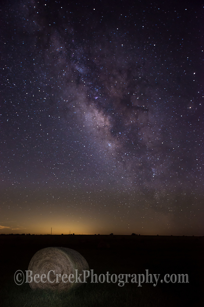 This is another haybay with the milkyway on a nice night in the Texas Hill Country. The galaxy shine bright over the hill country with the farmers haybales below.