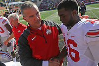 Ohio State Football head coach Urban Meyer shakes hands with Ohio State Buckeyes quarterback J.T. Barrett (16) following their win against the Maryland Terrapins at Byrd Stadium in College Park, Maryland on October 4, 2014. (Columbus Dispatch photo by Brooke LaValley)