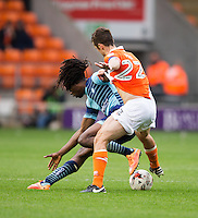 Marcus Bean of Wycombe Wanderers battles with Danny Pugh of Blackpool during the Sky Bet League 2 match between Blackpool and Wycombe Wanderers at Bloomfield Road, Blackpool, England on 20 August 2016. Photo by James Williamson / PRiME Media Images.