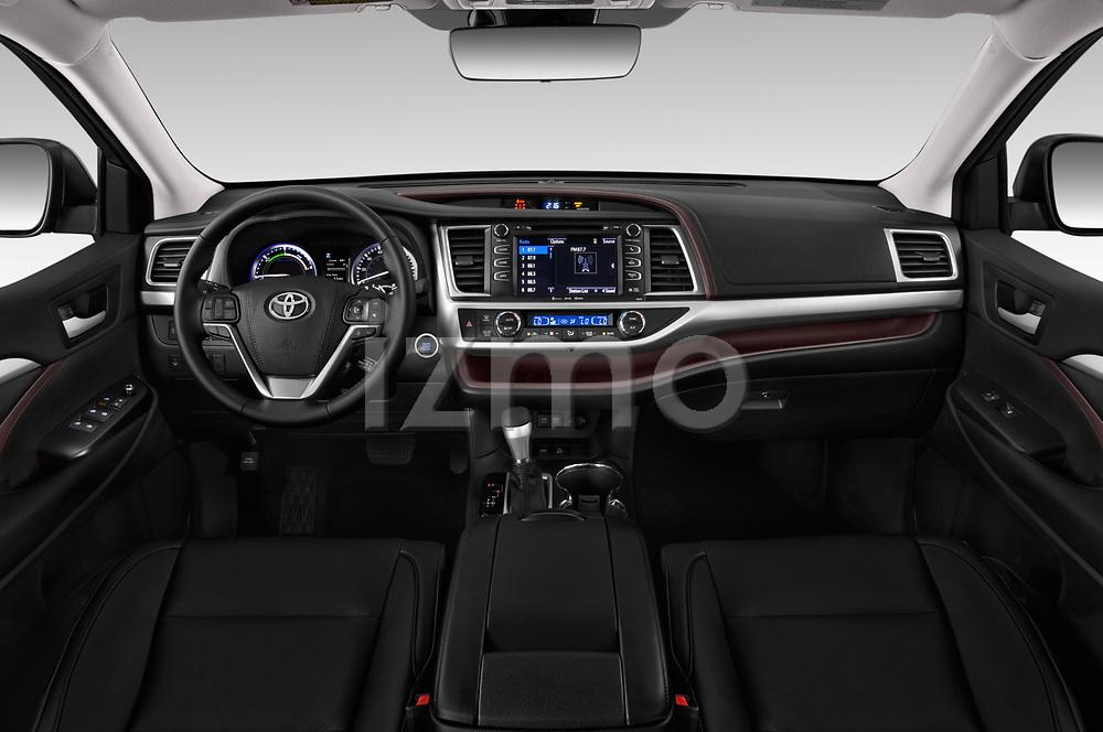 Stock photo of straight dashboard view of 2019 Toyota Highlander XLE 5 Door SUV Dashboard