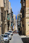 Narrow street historic housing in city centre of Valletta, Malta