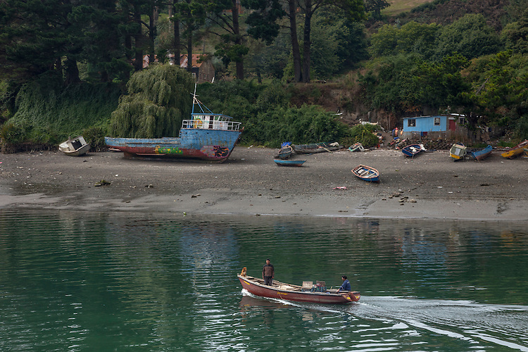 The peaceful shoreline scene at Puerto Montt's harbor area displays the simple life of the local people