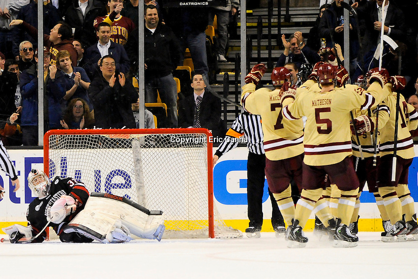 Boston College terriers celebrate a goal on Northeastern University Huskies goalie Chris Rawlings (37)  during the championship round of the Beanpot Tournament hockey between Boston College and Northeastern University held at TD Garden in Boston Massachusetts.  Eric Canha/CSM