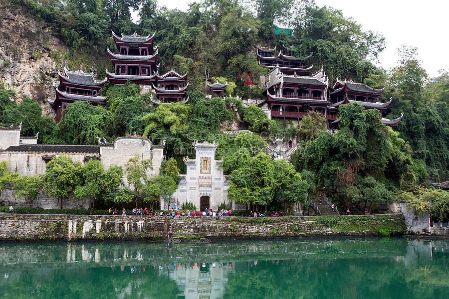 Zhenyuan, Guizhou, China.  Entrance to the Black Dragon Cave Palace (Qinglong Cave) and the Wuyang River.