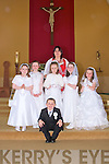 Children from Moyvane who received their 1st Holy Communion on Saturday from Fr John Lucid were Aoife Bowler, Eimear Shine, Rachael O'Connor, Ciara Hudson, Cayla Hannon and Jason O'Gorman pictured here with their teacher Mairead Murphy.