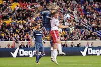 Frankie Hejduk (6) of the Los Angeles Galaxy and Jan Gunnar Solli (8) of the New York Red Bulls go up for a header. The New York Red Bulls defeated the Los Angeles Galaxy 2-0 during a Major League Soccer (MLS) match at Red Bull Arena in Harrison, NJ, on October 4, 2011.