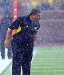 Michigan head coach Brady Hoke strains to watch game action through a heavy downpour in the third quarter of an NCAA college football game with Western Michigan, Saturday, Sept. 3, 2011, in Ann Arbor, Mich. (AP Photo/Tony Ding)