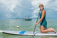 Jennica McEnery, Ohio, takes a Stand Up Paddleboard lesson at Bonia Jetski & Parasail, Bonita Beach, Florida. Photo by Debi Pittman Wilkey.
