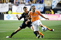 Brad Davis (11) of the Houston Dynamo is defended by Michael Farfan (21) of the Philadelphia Union. The Philadelphia Union and the Houston Dynamo played to a 1-1 tie during a Major League Soccer (MLS) match at PPL Park in Chester, PA, on August 6, 2011.