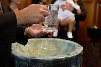 Montreal (Qc) CANADA - 2008 file - Holy water in a baby baptism held in a Catholic Church