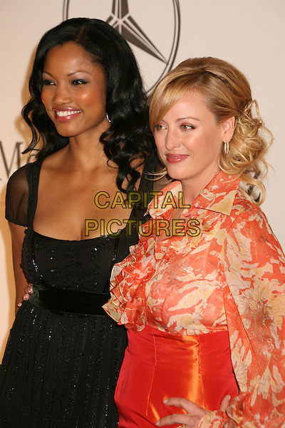 GARCELLE BEAUVAIS- NILON & VIRGINIA MADSEN.17th Annual Carousel of Hope Ball at the Beverly Hilton Hotel, Beverly Hills, California, USA..October 28th, 2006.Ref: ADM/BP.half length black length orange satin sheer pattern  .www.capitalpictures.com.sales@capitalpictures.com.©Byron Purvis/AdMedia/Capital Pictures.