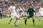 Real Madrid's Luka Modric and Gareth Bale and Real Betis's Cristian Tello during La Liga match between Real Madrid and Real Betis at Santiago Bernabeu Stadium in Madrid, Spain September 20, 2017. (ALTERPHOTOS/Borja B.Hojas)