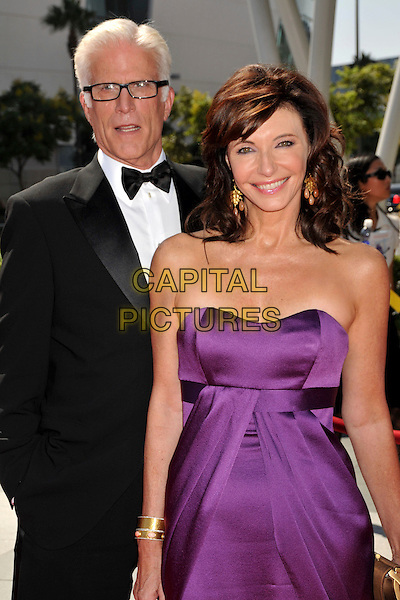 TED DANSON & MARY STEENBERGEN .61st Annual Creative Arts Emmy Awards held at Nokia Theatre LA Live, Los Angeles, California, USA, .12th September 2009..emmys half length purple dress long maxi glasses strapless black tux tuxedo bow tie couple suit gold clutch bag cuff bracelet .CAP/ADM/BP.©Byron Purvis/Admedia/Capital Pictures