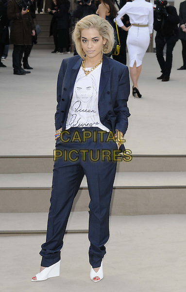 Rita Ora.attended the Burberry Prorsum London Fashion Week a/w 2013 catwalk show, Kensington Gardens, Hyde Park, London, England..February 18th, 2013.LFW full length black blazer blue navy white top open toe shoes wedges hands in pockets queen delevingne .CAP/CAN.©Can Nguyen/Capital Pictures.