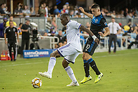 SAN JOSE,  - SEPTEMBER 1: Kamal Miller #27 of the Orlando City SC and Cristian Espinoza #10 of the San Jose Earthquakes during a game between Orlando City SC and San Jose Earthquakes at Avaya Stadium on September 1, 2019 in San Jose, .