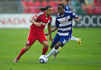 July 24, 2010  FC Dallas forward/midfielder Atiba Harris #16 and Toronto FC midfielder Dwayne De Rosario #14  in action during a game between FC Dallas and Toronto FC at BMO Field in Toronto..Final score was 1-1.