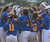 East Meadow teammates celebrate after a solo home run by Christina Loeffler #45 in the bottom of the third inning of Game 3 of the Nassau County varsity softball Class AA final against Long Beach at Mitchel Athletic Complex on Friday, May 26, 2017. The homer extended the Jets' lead to 3-1. East Meadow went on to win by that same score to take the best-of-three series two games to one.