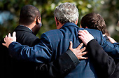United States President George W. Bush poses for a picture while walking from Marine One to the White House February 3, 2008 in Washington, DC.  President Bush spent the weekend at the presidential retreat Camp David in Maryland.  <br /> Credit: Brendan Smialowski / Pool via CNP