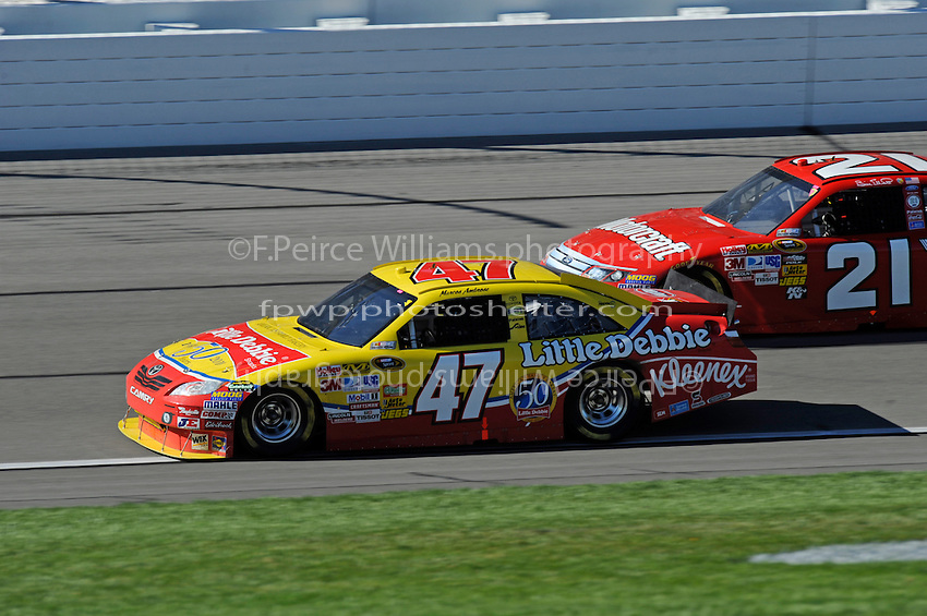 Marcos Ambrose (#47) and Bill Elliott (#21)