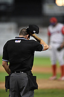 Umpire Christopher Stump in between innings during a game between the Williamsport Crosscutters and Batavia Muckdogs on August 25, 2014 at Dwyer Stadium in Batavia, New York.  Williamsport defeated Batavia 3-0.  (Mike Janes/Four Seam Images)
