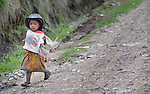 A girl walks along a road in San Jose la Frontera, a small Mam-speaking Maya village in Comitancillo, Guatemala.