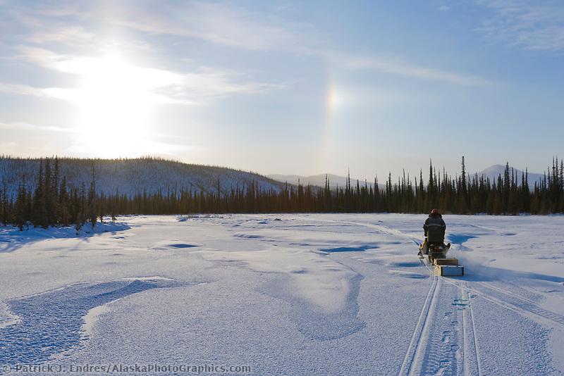 Snow machine on the Mathews river, Brooks range, Arctic, Alaska.
