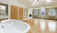 BNPS.co.uk (01202)558833<br /> Pic: TavistockBow/BNPS<br /> <br /> Open plan bathroom...<br /> <br /> It may not be in the country, but £3.5 million buys you this very big house in trendy Covent Garden - owned by Blur bassist Alex James in the early 2000's.<br /> <br /> A stylish late 19th century converted warehouse formerly owned by Blur guitarist turned cheesemaker Alex James has emerged on the market for £3.5million.<br /> <br /> The musician lived at Mercer Street, in the Seven Dials area of Covent Garden, for several years in the early 2000s before relocating to the country.<br /> <br /> The handsome townhouse is a stone's throw from Neal's Yard Dairy, a cheese shop where James no doubt indulged his passion for the produce, as well as former haunts The Ivy and Groucho Club.<br /> <br /> The two bedroom property with a balcony overlooking Ching Court is available to buy through estate agent Tavistock Bow, who are also offering it to rent for £1,650 per week.<br /> <br /> The five storey house was remodelled by acclaimed architect Sir Terry Farrell between 1983 and 1985 as part of the regeneration of the area, subsequently earning Grade II Listed status for its 'architectural merit'.