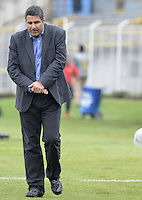 BOGOTA -COLOMBIA, 10-11-2013. Santiago Escobar técnico de Once Caldas gesticula durante partido contra Patriotas FC por la fecha 18 de la Liga Postobón II 2013 realizado en el estadio  Metropolitano de Techo de Bogotá./ Santiago Escobar coach of Once Caldas gestures during match against Patriotas FC for the 18th date of Postobon  League 2013-1 played at  Metropolitano de Techo stadium in Bogota. Photo: VizzorImage/ Gabriel Aponte /STR