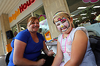 L-R face paint artist Alison Hope and Ruby Davies.
