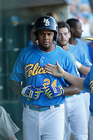 Myrtle Beach Pelicans third baseman Jeimer Candelario (24) in the dugout during a game against the Potomac Nationals at Ticketreturn.com Field at Pelicans Ballpark on May 23, 2015 in Myrtle Beach, South Carolina.  Myrtle Beach defeated Potomac 7-3. (Robert Gurganus/Four Seam Images)