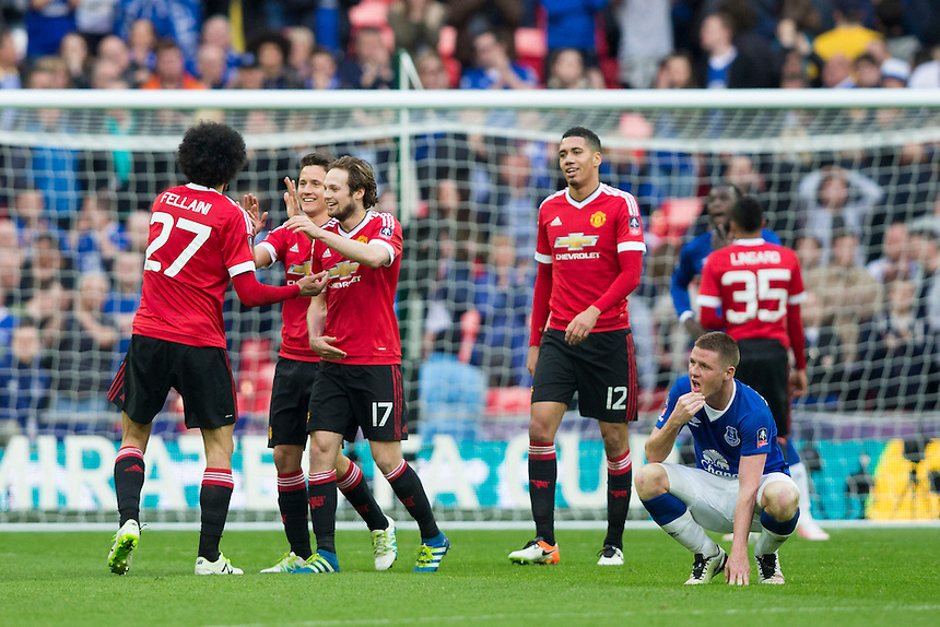 Dejection for Everton's James McCarthy as Manchester United players celebrate their victory at full time<br /> <br /> Photographer Craig Mercer/CameraSport<br /> <br /> Football - The FA Cup Semi Final - Everton v Manchester United - Saturday 23rd April 2016 - Wembley - London<br /> <br /> &copy; CameraSport - 43 Linden Ave. Countesthorpe. Leicester. England. LE8 5PG - Tel: +44 (0) 116 277 4147 - admin@camerasport.com - www.camerasport.com