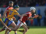 Billy Connors of Clare in action against David Griffin of Cork during their Munster Hurling League game at Cusack Park. Photograph by John Kelly.