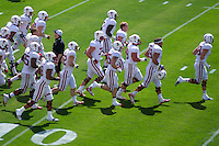 STANFORD, CA- April 13, 2013- The Stanford Cardinal and Whites Spring Game. Defense runs onto the field getting ready for the Cardinal and White  spring game. <br /> <br /> isiphotos.com