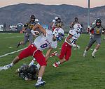 Reno fullback Will Barnard runs away from Galena's Niko Pezonella during their football game played on Friday night Sept. 16, 2016 at Galena High School.