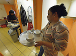 Begum Ali carries dirty dishes while her daughter Lutfa prepares food in the small restaurant they run in Budapest, Hungary. Refugees from Bangladesh, they came to Hungary in 2013, were granted refugee status, and opened the restaurant in 2014.<br /> <br /> As Hungary dealt with a massive flow of new refugees in 2015, the country wrestled with its responsibility to the newcomers. Yet old-timers like the Ali family report they have felt welcomed during the years they have lived in Hungary.
