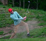 Zach Bohmer of Ritenour High School hits out of a bunker at the 14th hole. Golfers in Suburban Central and Suburban XII Conference schools competed in a tournament at the Gateway National Golf Course in Madison, Illinois on Wednesday April 25, 2018.  Tim Vizer | Special to STLhighschoolsports.com