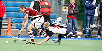 Will Naylor (R) of Hampstead challenges Jon Bleby during the England Hockey League Mens Premier Division game between Hampstead & Westminster HC and Loughborough Students at The Paddington Recreation Ground, London on Sun Nov 8, 2009