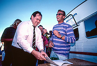 Jeffreys Bay, Eastern Cape, South Africa circa1991. <br /> The presentation for the Country Feeling Dream Sequence surf contest. The concept for the unique Dream Sequence event was created by former pro surfer Derek Hynd (AUS),  and it was won by  Luke Egan (AUS)  with the first prize being a block of land over looking the iconic surf break. Egan is signing the deed of ownership to the land after his win. Photo:joliphotos.com
