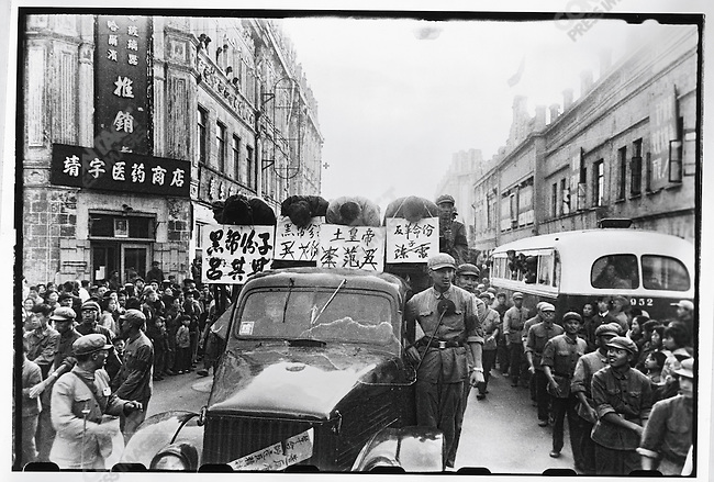 After a month of criticism sessions, Lu Qi'en, the mayor of Harbin (far left), Chen Lei, Li Fanwu, and Wang Yilun (right to left) are paraded through the streets of Harbin in trucks, their names and accusations - counterrevolutionary, local despot, and black gang element - prominently displayed on placards around their necks. Harbin, 12 September 1966