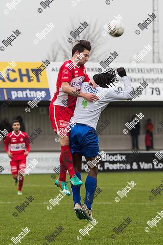 2015-01-25 / Voetbal / Seizoen 2014-2015 / Hoogstraten-Tienen/ Ruben Tilburghs (HVV) in een kopbalduel met Maxime Renson (Tienen)<br /> <br /> Foto: Mpics.be