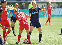 Portland, OR - Saturday July 15, 2017: Samantha Mewis, Tyler Lussi during a regular season National Women's Soccer League (NWSL) match between the Portland Thorns FC and the North Carolina Courage at Providence Park.