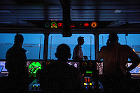 The Captain, pilot, helmsman and chief officer on the bridge as the Mary Maersk, the largest container ship in the world, is steered out of Gothenburg Port in the early hours of the morning.