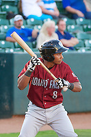 Carlos Garcia (8) of the Idaho Falls Chukars at bat against the Ogden Raptors in Pioneer League play at Lindquist Field on September 5, 2013 in Ogden Utah.  (Stephen Smith/Four Seam Images)