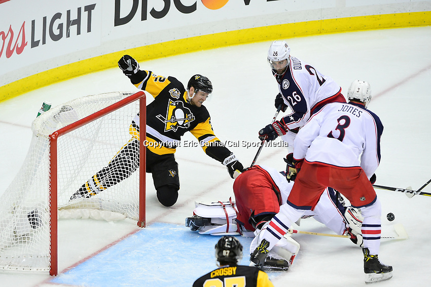Thursday, April 20, 2017: Pittsburgh Penguins right wing Patric Hornqvist (72) fights to knock the puck from Columbus Blue Jackets left wing Lauri Korpikoski (29) during game 5 of round one of the National Hockey League Eastern Conference Stanley Cup Playoffs between the Columbus Blue Jackets and the Pittsburgh Penguins, held at PPG Paints Arena, in Pittsburgh, PA. Pittsburgh defeats Columbus 5-2 to win the best of seven series 4 games to 1and advances to round two of the Eastern Conference Playoffs. Eric Canha/CSM