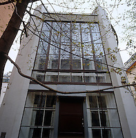 The full-length window of the simple yet grand Modernist facade of the Melnikov residence